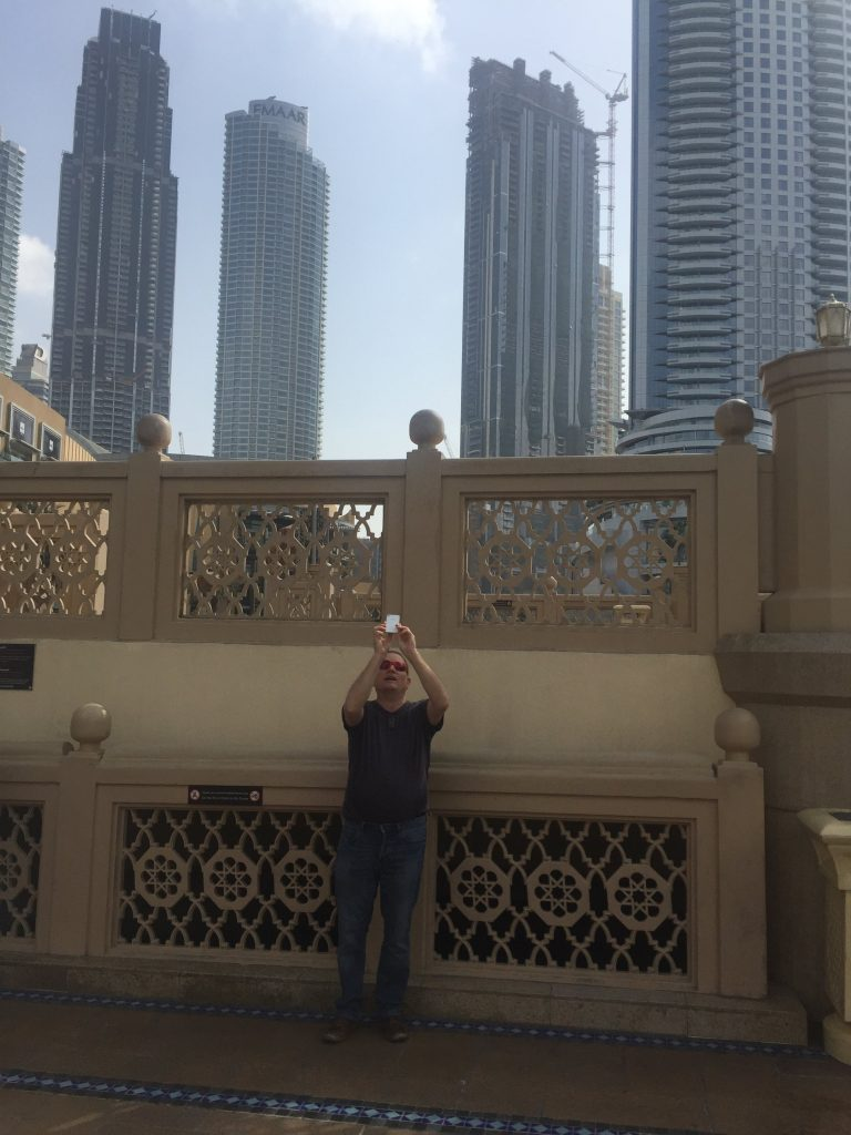 We Travel to India. Here's Paul trying to get the perfect photo of the Burj Khalifa in Dubai