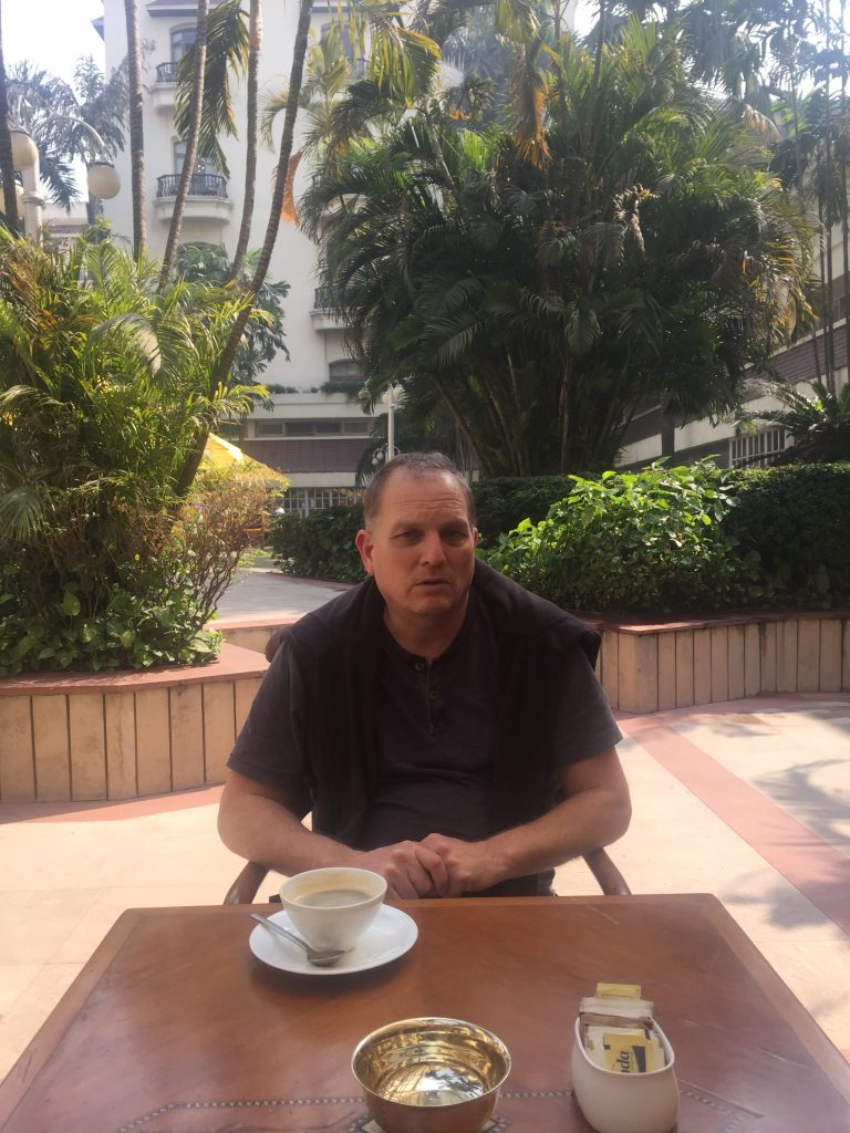 We Travel to India Paul relaxing with a coffee at the Oberoi Grand Hotel in Kolkata