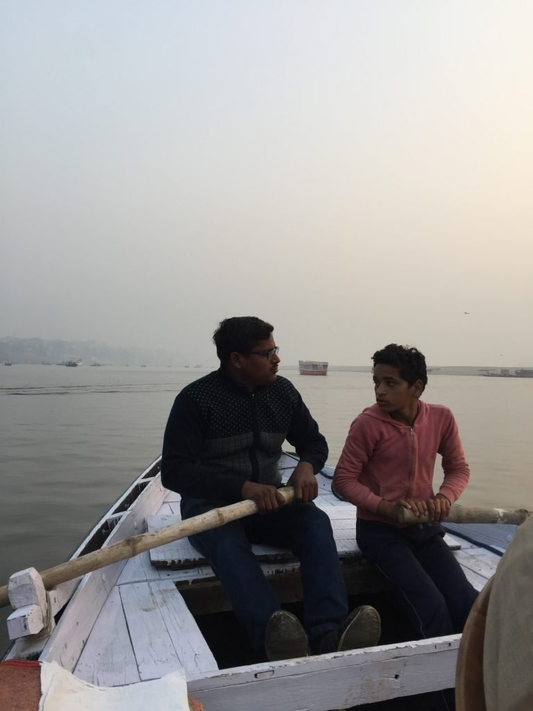 Varanasi Sightseeing Father and Son Rowing Team Boat Tour on the Ganges