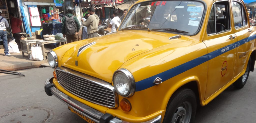 We rode in a yellow taxi on our Kolkata City Tour