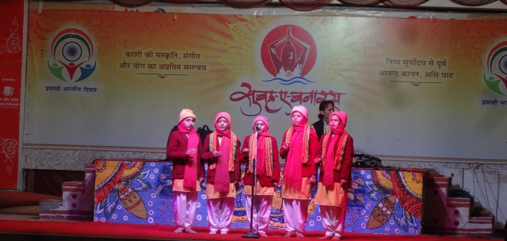 Essential Varanasi Sightseeing Children Singing at the Morning Ceremony at Assi Ghat