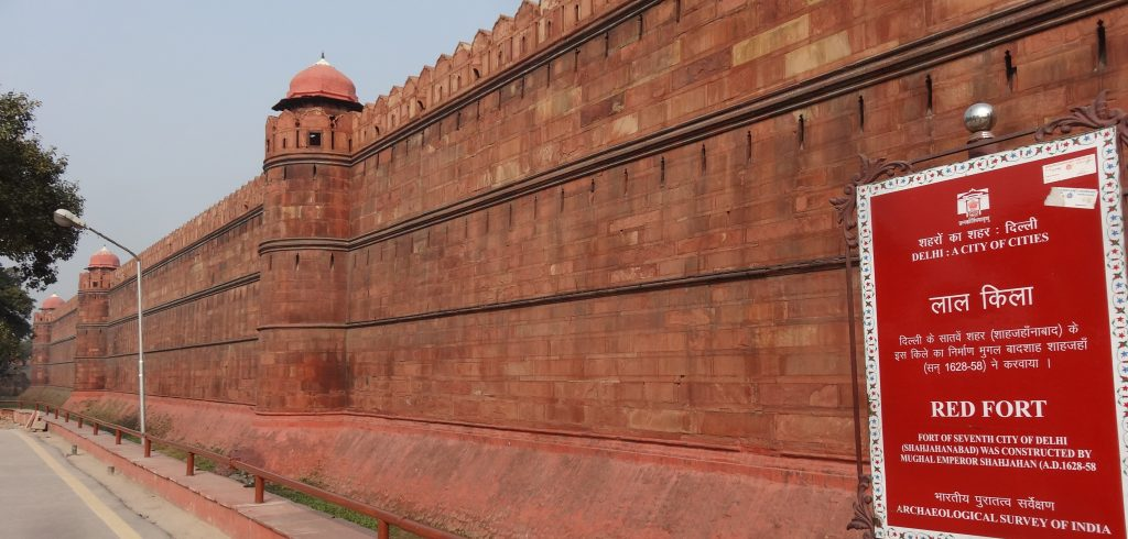Walking along outside the walls of the Red Fort in Delhi