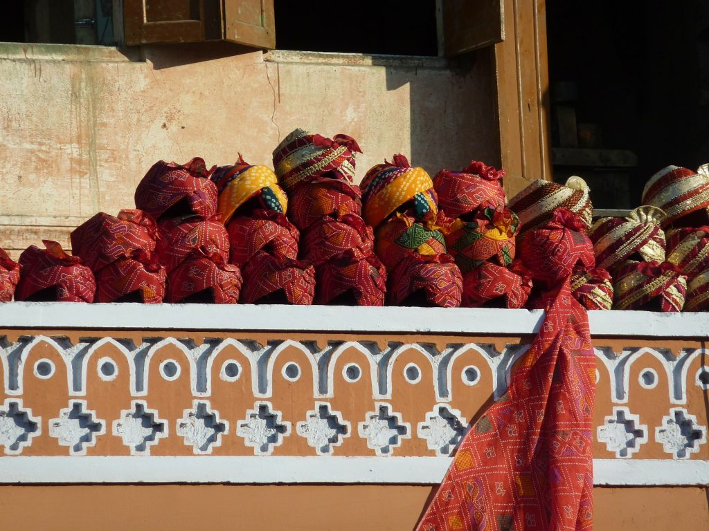 Traditional hats for sale in the market on our Jaipur Sightseeing Tour
