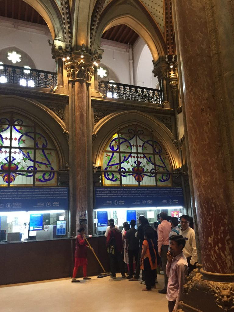 Buying tickets for the train at Mumbai CST (Chhatrapati Shivaji Terminus)