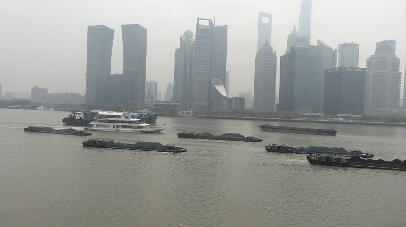 Coal barges passing the ferry on the way down the Huangpu River