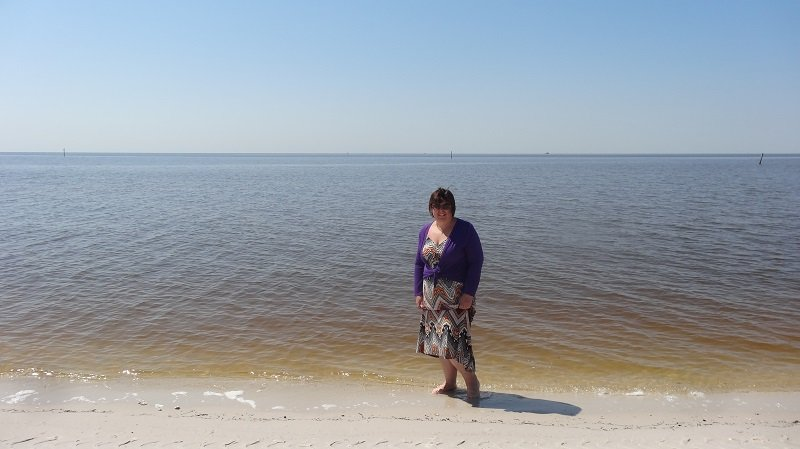 Dipping my toes in the Gulf on our Seattle to Florida Road Trip