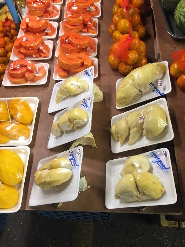 Durian and other fruits packaged for sale at the market